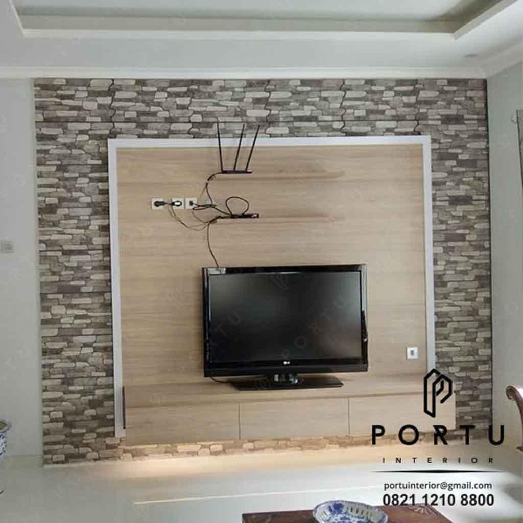 contoh kabinet tv dengan kombinasi keramik batu produksi Portu Interior