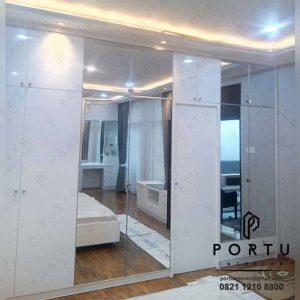 lemari baju minimalis kombinasi cermin dari Portu Interior