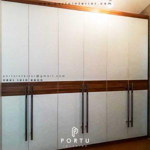 contoh lemari pakaian pintu swing minimalis by Portu Interior